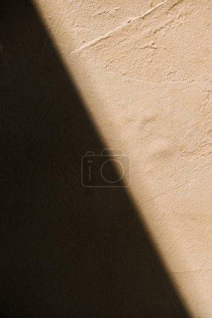 image plein cadre rustique mur beige avec le fond de l'ombre