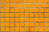 full frame image of orange ceramic tile wall background