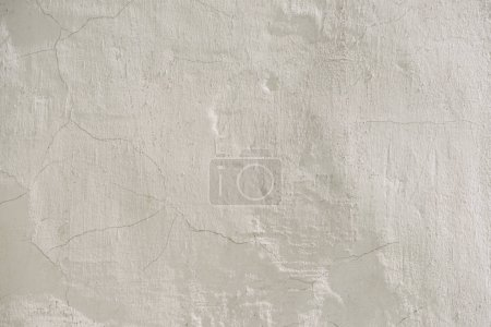 full frame image of cracked white wall background