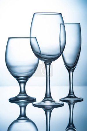 silhouettes of different empty glassware with reflections