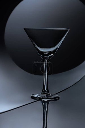 silhouette of empty martini glass on dark background