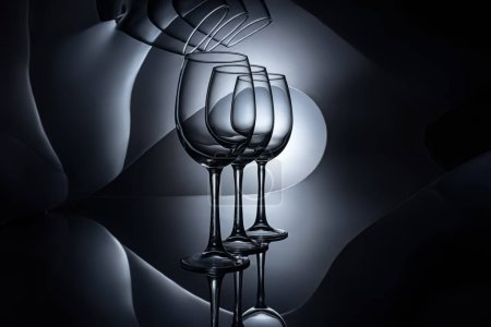 row on empty wine glasses, dark studio shot
