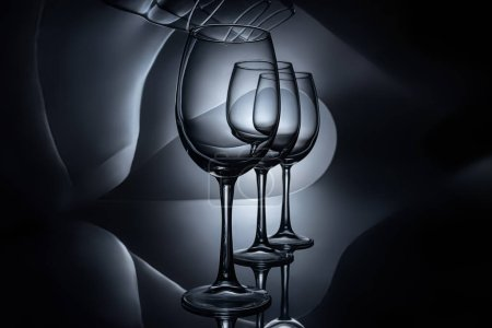 row on empty luxury wine glasses, dark studio shot