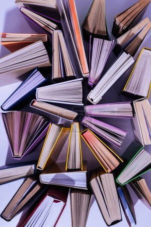 Photo for Elevated view of scattered stack of books on table - Royalty Free Image