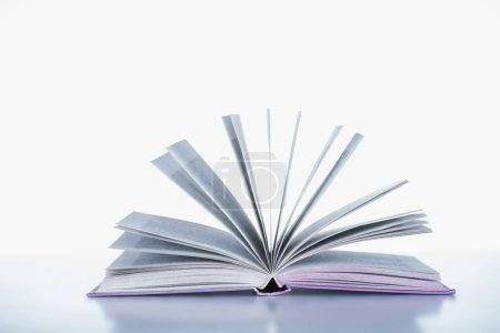 one open book on white surface