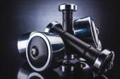 close-up view of various dumbbells and reflection, sport and healthy lifestyle concept