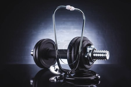 close-up view of stethoscope and dumbbell, healthy lifestyle concept