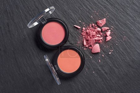 Broken blush by pressed blush on dark slate background