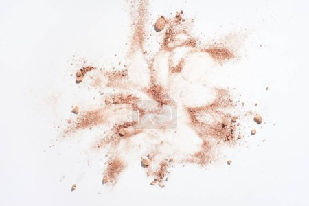 Smudges of powder foundation on white background