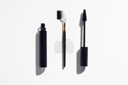 Mascara and eye lashes brushes on white background