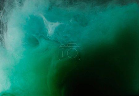 Photo pour Vue rapprochée du fond abstrait avec de l'encre verte fluide - image libre de droit