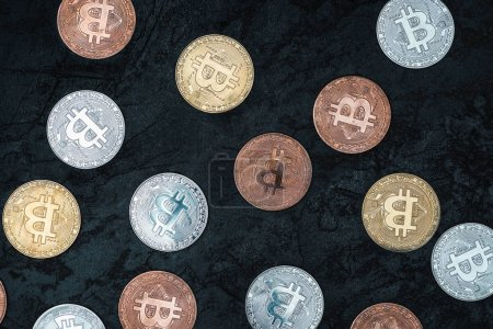 top view of arranged various bitcoins on dark marble tabletop