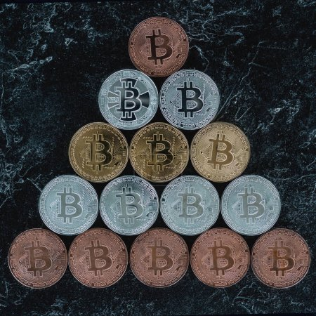 top view of arranged bitcoins on marble tabletop