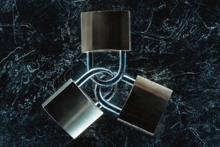 top view of metal locks on dark marble tabletop