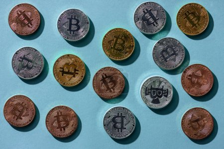top view of arranged various bitcoins on blue tabletop