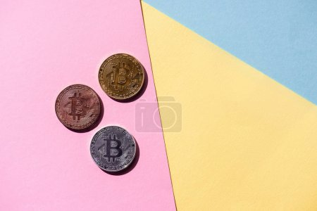 top view of arranged various bitcoins on colorful background