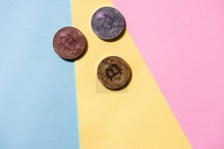 top view of arranged bitcoins on colorful background