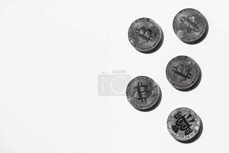 top view of arranged silver bitcoins on white backdrop