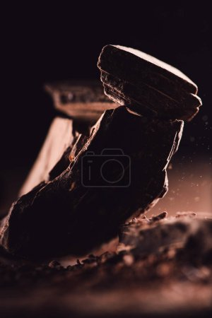 Photo for Close up shot of arranged pieces of dark chocolate on black background - Royalty Free Image