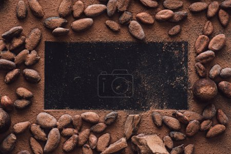 elevated view of empty surface surrounded cocoa beans covered by grated chocolate