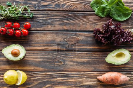top view of arrangement of fresh and ripe vegetables on wooden surface