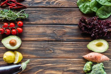 top view of arrangement of fresh and ripe vegetables on wooden surface with copy space