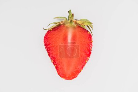 Single cut strawberry isolated on white background