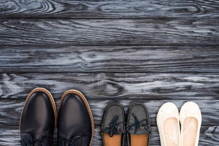 top view of father and kids leather shoes on wooden surface, Happy fathers day concept