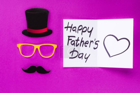 top view of gentleman face with Happy fathers day greeting card