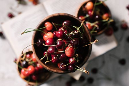 top view of tasty healthy organic cherries in bowl, selective focus