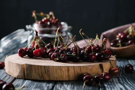 close-up view of fresh ripe sweet cherries on wooden chopping board