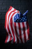 vertical waving united states flag in front of black brick wall, Independence Day concept