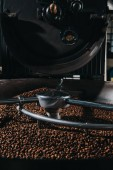 Roasting and mixing process in traditional coffee roaster cylinder