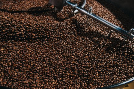 Roasting coffee beans in industrial coffee roaster