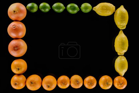 top view of frame made of ripe various citrus fruits isolated on black