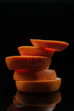 close-up shot of stacked slices of orange isolated on black