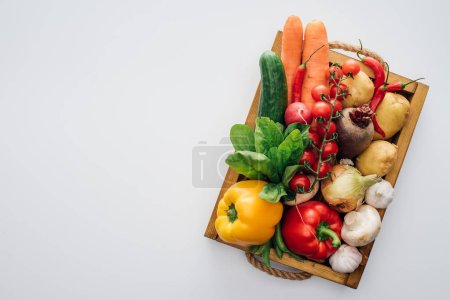 Photo for Top view of box with fresh ripe vegetables isolated on white - Royalty Free Image