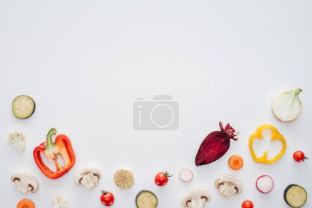slices of fresh healthy vegetables isolated on white background