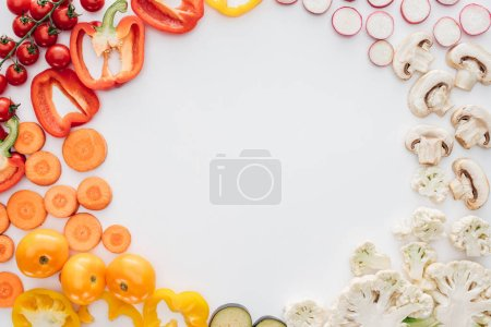 Photo for Top view of fresh raw sliced organic vegetables isolated on white background - Royalty Free Image