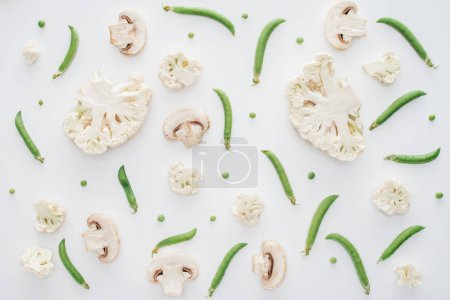 Photo for Top view of fresh sliced cauliflower, mushrooms and green peas isolated on white background - Royalty Free Image