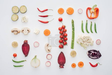 top view of fresh raw sliced vegetables isolated on white