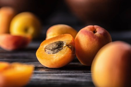 selective focus of ripe apricots on wooden table
