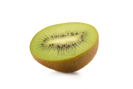 close up view of piece of kiwi fruit isolated on white