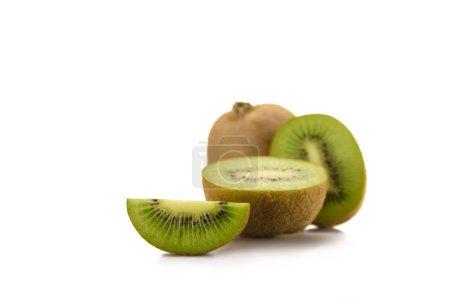 close up view of arranged fresh kiwi fruits isolated on white