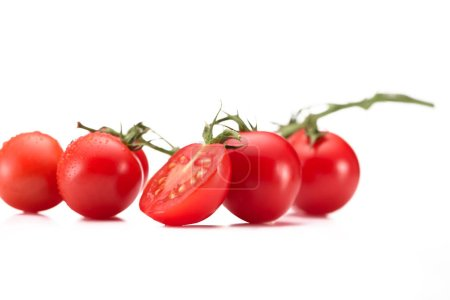 Photo for Close up view of ripe cherry tomatoes on twig isolated on white - Royalty Free Image