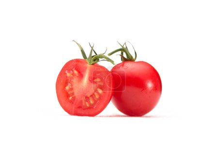 close up view of cherry tomato pieces isolated on white