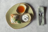 flat lay with samosas in Phyllo dough stuffed with spinach and paneer decorated with germinated seeds of alfalfa and sunflower served on plate on grey tabletop