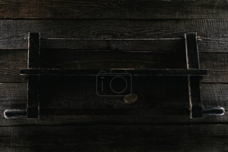 top view of vintage rusty saw on wooden planks tabletop