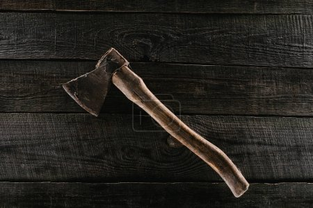 top view of vintage axe on wooden tabletop background