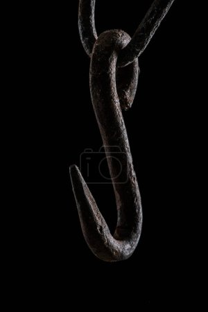 close up view of vintage rusty hook isolated on black